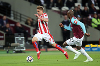 Moritz Bauer of Stoke City and Angelo Ogbonna of West Ham United during West Ham United vs Stoke City, Premier League Football at The London Stadium on 16th April 2018