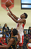 Jayson Robinson #5 of Amityville drives to the net during a Suffolk County League VI varsity boys basketball game against Wyandanch at Amityville High School on Tuesday, Jan. 2, 2018. Amityville won by a score of 95-50.