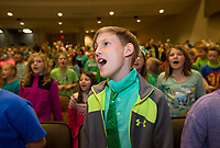 NWA Democrat-Gazette/JASON IVESTER<br /> Maddox Owens, Thomas Jefferson Elementary third-grader, sings along with other students Friday, March 17, 2017, during Kidz Sing at the Arend Arts Center in Bentonville. Third-graders from Bentonville elementary schools learned the songs to be performed during their music classes.