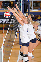24 September 2010:  FIU's Ines Medved (11) and Sabrina Gonzalez (12) block a shot at the net in the second set as the FIU Golden Panthers defeated the University of Denver Pioneers, 3-0 (29-27, 25-16, 25-20), at U.S Century Bank Arena in Miami, Florida.