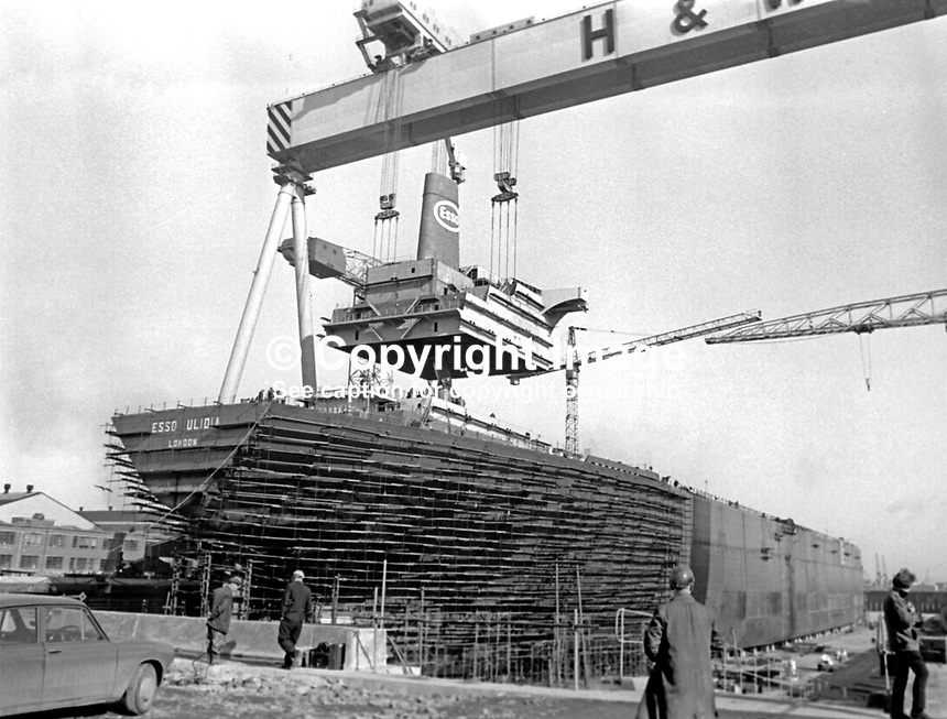 Esso Ulidia under construction at the Belfast, N Ireland shipyard of Harland &amp; Wolff. The giant crane &quot;Goliath&quot; is manoevering the upper decks superstructure into place. 5th March 1970. It went to the breakers yard in 1983. 197003050095b<br />