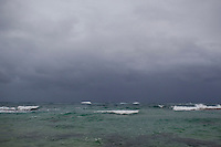A storm rolls in over the reef near Haena, Kauai, HI