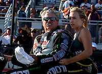 Sep 13, 2013; Charlotte, NC, USA; Funny car driver John Force with his daughter NHRA top fuel dragster driver Brittany Force on the back during qualifying for the Carolina Nationals at zMax Dragway. Mandatory Credit: Mark J. Rebilas-