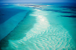 Numerous small islands make up this British colony of the Turks and Caicos Islands.  Pearlescent sand bars are shaped by the clear waters of the Caribbean Sea.