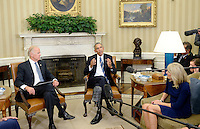 United States President Barack Obama, center, with US Vice President Joe Biden, left, and Dr. Jill Biden, right, meet to discuss the release of the Cancer Moonshot Report in the Oval Office of the White House on October 17, 2016 in Washington, DC. <br /> Credit: Olivier Douliery / Pool via CNP /MediaPunch