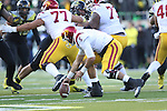 Nov 21, 2015; Eugene, OR, USA; USC Trojans quarterback Cody Kessler (6) mishandles the ball which lead to a turnover against the Oregon Ducks at Autzen Stadium. <br /> Photo by Jaime Valdez