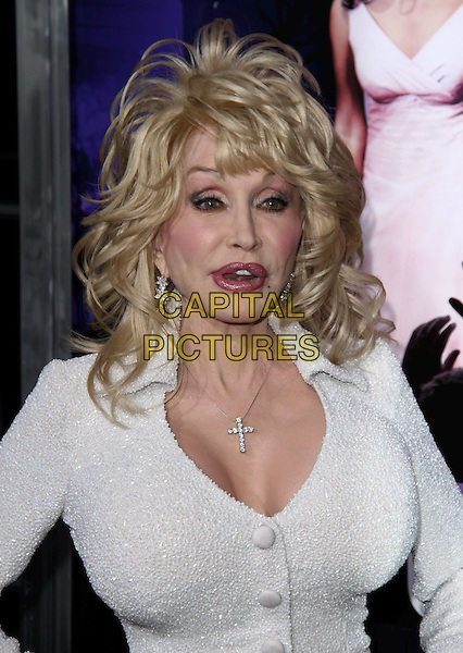 "Dolly Parton.""Joyful Noise"" Los Angeles Premiere held at Grauman's Chinese Theatre, Hollywood, California, USA..January 9th, 2012.headshot portrait white dress sparkly cleavage necklace cross crucifix mouth open funny.CAP/ADM/CH.©Charles Harris/AdMedia/Capital Pictures"