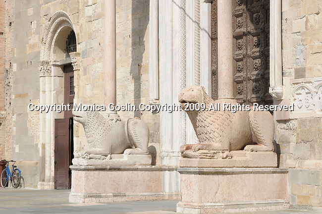 Stone lions in front of the Cathedral of Parma in Italy.