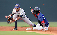 Shortstop Kelvin Castro (29) of the Charleston RiverDogs applies the tag too late as Wilfred Pichardo (2) of the Greenville Drive steals second in a game on Aug. 24, 2010, at Fluor Field at the West End in Greenville, S.C. Photo by: Tom Priddy/Four Seam Images