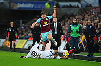 Burnley's Charlie Taylor is tackled by Swansea City's Jordan Ayew<br /> <br /> Photographer Ashley Crowden/CameraSport<br /> <br /> The Premier League - Swansea City v Burnley - Saturday 10th February 2018 - Liberty Stadium - Swansea<br /> <br /> World Copyright &copy; 2018 CameraSport. All rights reserved. 43 Linden Ave. Countesthorpe. Leicester. England. LE8 5PG - Tel: +44 (0) 116 277 4147 - admin@camerasport.com - www.camerasport.com