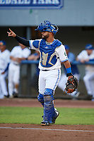 Bluefield Blue Jays catcher Andres Guerra (17) signals to the defense during the second game of a doubleheader against the Bristol Pirates on July 25, 2018 at Bowen Field in Bluefield, Virginia.  Bristol defeated Bluefield 5-2.  (Mike Janes/Four Seam Images)