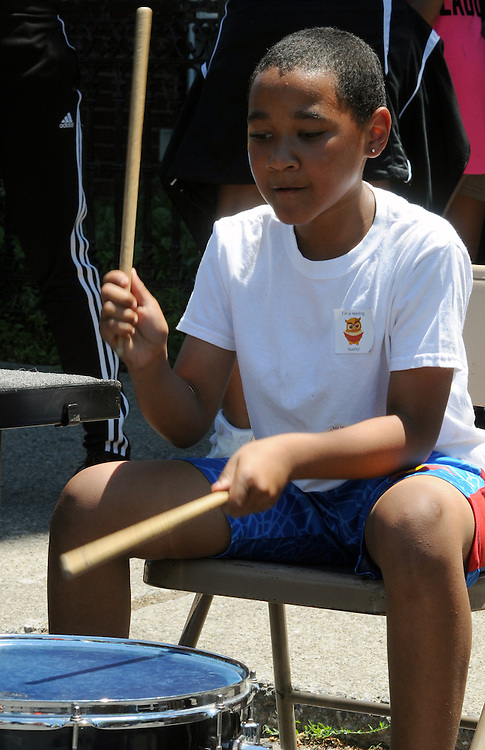 One of those who drummed along with the Percussion Orchestra of Kingston (POOK) performing at the 11th Annual Mid-town Make a Difference Day Celebration on Franklin Street, in Kingston, NY on Saturday, June  18, 2016. Photo by Jim Peppler. Copyright Jim Peppler 2016.