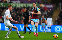 Swansea City's Sam Clucas battles with Burnley's Ashley Barnes<br /> <br /> Photographer Ashley Crowden/CameraSport<br /> <br /> The Premier League - Swansea City v Burnley - Saturday 10th February 2018 - Liberty Stadium - Swansea<br /> <br /> World Copyright &copy; 2018 CameraSport. All rights reserved. 43 Linden Ave. Countesthorpe. Leicester. England. LE8 5PG - Tel: +44 (0) 116 277 4147 - admin@camerasport.com - www.camerasport.com