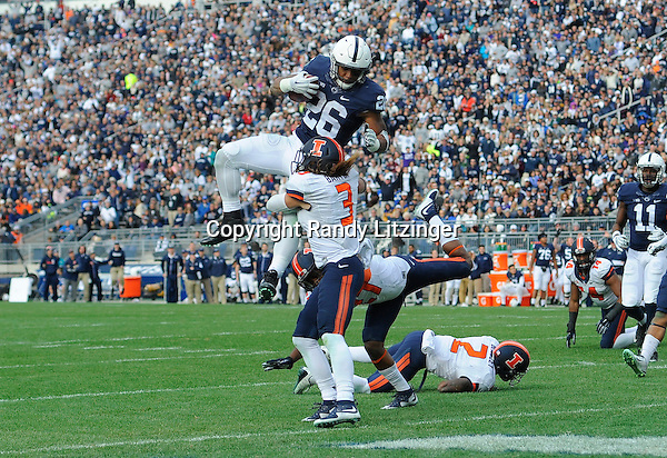 31 October 2015:  Penn State RB Saquon Barkley (26) is hit by Illinois S Taylor Barton (3) after hurdling Illinois CB V'Angelo Bentley (2) during a 7 yard touchdown run. The Penn State Nittany Lions defeated the Illinois Fighting Illini 39-0 at Beaver Stadium in State College, PA. (Photo by Randy Litzinger/Icon Sportswire)