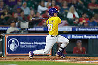 Alex Milazzo (20) of the LSU Tigers follows through on his swing against the Oklahoma Sooners in game seven of the 2020 Shriners Hospitals for Children College Classic at Minute Maid Park on March 1, 2020 in Houston, Texas. The Sooners defeated the Tigers 1-0. (Brian Westerholt/Four Seam Images)