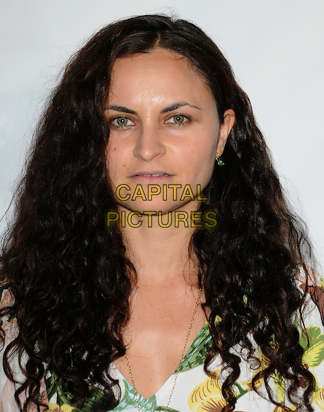 RAIN PHOENIX.at the Los Angeles Nomadic Division 1st Annual Benefit held at The Sunset Tower Hotel in West Hollywood, California, USA, July 15th 2010                                                                               portrait headshot curly hair green white print .CAP/RKE/DVS.©DVS/RockinExposures/Capital Pictures.