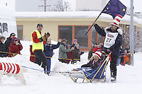 Hugh Neff Saturday, March 3, 2012 Hugh Neff waves an Alaska State flag while wearing his cat-in-the-hat, hat on 4th avenue during the Ceremonial Start of Iditarod 2012 in Anchorage, Alaska.