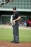 Home plate umpire Kyle Wallace between innings of the South Atlantic League game between the Hagerstown Suns and the Kannapolis Intimidators at CMC-Northeast Stadium on July 19, 2015 in Kannapolis, North Carolina.  The Suns defeated the Intimidators 9-4.  (Brian Westerholt/Four Seam Images)