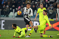 Calcio, Serie A: Juventus vs Bologna. Torino, Juventus Stadium, 8 gennaio 2017.<br /> Juventus&rsquo; Paulo Dybala, center, is challenged by Bologna's Domenico Maietta, left, and Marios Oikonomou during the Italian Serie A football match between Juventus and Bologna at Turin's Juventus Stadium, 8 January 2017. Juventus won 3-0.<br /> UPDATE IMAGES PRESS/Manuela Viganti