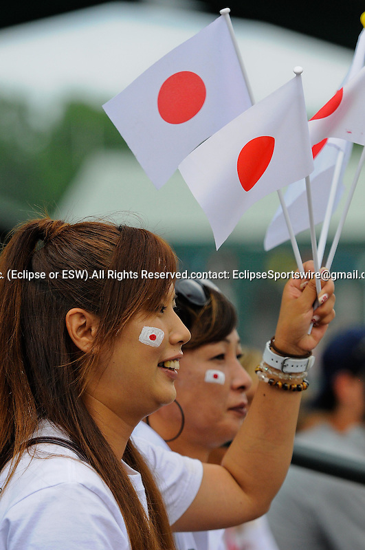 A fan supports Team Japan in the World Championship Game at the Cal Ripken World Series in Aberdeen, Maryland on August 21, 2011
