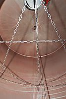 fermentation tank interior chains to break the cap at rack-and-return chateau lestrille bordeaux france