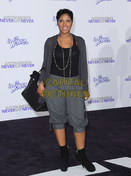 "TONI BRAXTON .attending the Paramount Pictures' L.A. Premiere of ""Justin Bieber: Never Say Never"" held at The Nokia Theater Live in Los Angeles, California, USA,.February 8th 2011..full length grey gray cardigan cropped trousers black ankle boots bag silver necklace .CAP/RKE/DVS.©DVS/RockinExposures/Capital Pictures."