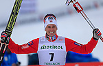 Norway's Ola Vigen Hattestad reacts before the podium of the FIS Ski World Cup 1.3 Km men's Sprint Free finals, on February 2, 2014 in Dobbiaco, Toblach. <br />