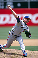 OAKLAND, CA - Roger Clemens of the Toronto Blue Jays pitches during a game against the Oakland Athletics at the Oakland Coliseum in Oakland, California in 1997.  Photo by Brad Mangin