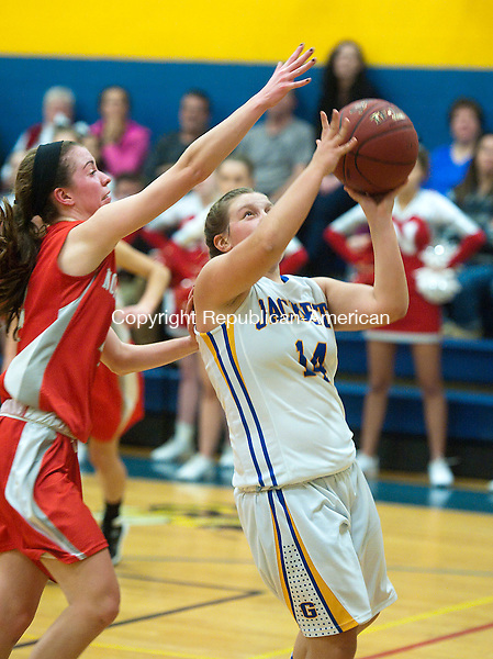 WINSTED, CT--- -011516JS01--Gilbert's  Jillian Wexler (14) get fouled by Northwestern's Marissa Swartley (4) while putting up a shot during their game Friday at the Gilbert School in Winsted. <br />  Jim Shannon Republican-American