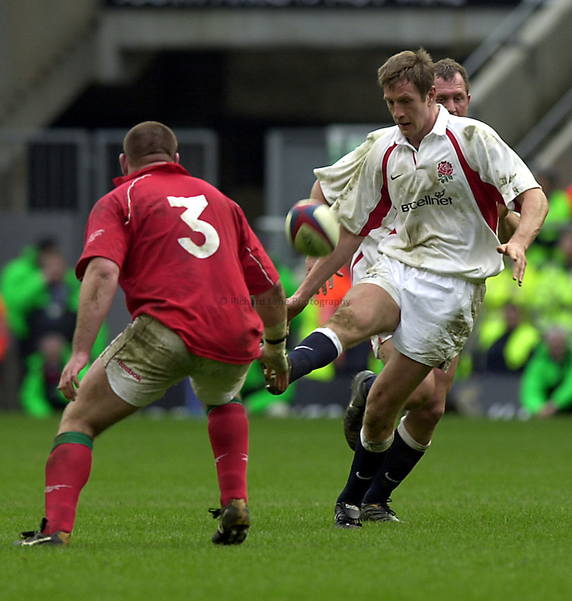 Photo. Richard Lane.Lloyds TSB Six Nations Championship. England v Wales at Twickenham. 23-3-2002.Will Greenwood chips over Chris Anthony.
