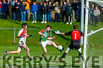 Mid Kerry's Caolim Teahan about to shoot but Kilcummin keeper Brendan Kealy spreads himself to twart his effort in the County Football championship game in Killorglin on Sunday.