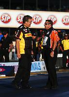 Jul. 26, 2013; Sonoma, CA, USA: NHRA funny car crew chief Jon Oberhofer (left) talks to Rob Wendland during qualifying for the Sonoma Nationals at Sonoma Raceway. Mandatory Credit: Mark J. Rebilas-