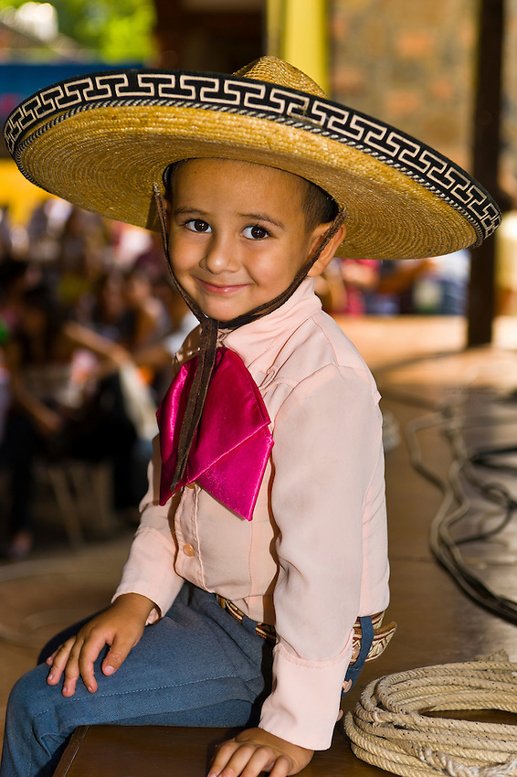 Little boy performing rope tricks during charreria performance at the Casa Herradura tequila distillery, town of Tequila, Jalisco, Mexico