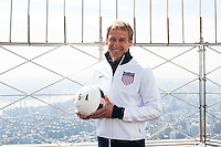 U.S. men's head coach Jurgen Klinsmann poses for a photo on the observation deck of the Empire State Building during the centennial celebration of U. S. Soccer in New York, NY, on April 05, 2013.