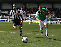Jim Goodwin (left) and Eoin Doyle chase for the ball in the St Mirren v Hibernian Clydesdale Bank Scottish Premier League match played at St Mirren Park, Paisley on 29.4.12.