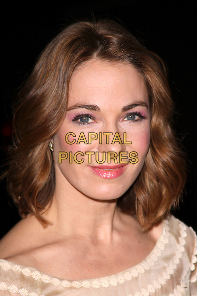 """NIA ROBERTS.""""Patagonia"""" UK film premiere held at the Odeon Covent Garden cinema, Shaftesbury Avenue, London, England, UK, 2nd March 2011..portrait headshot make-up pink lipstick eyeshadow blusher pale yellow beauty flowers .CAP/AH.©Adam Houghton/Capital Pictures."""