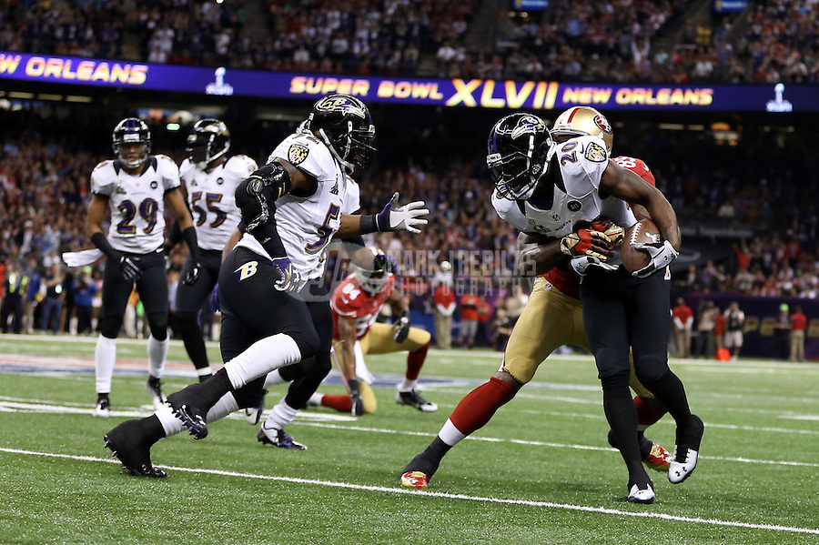 Feb 3, 2013; New Orleans, LA, USA; Baltimore Ravens free safety Ed Reed (20) is tackled by San Francisco 49ers tight end Vernon Davis (85) after an interception in the second quarter in Super Bowl XLVII at the Mercedes-Benz Superdome. Mandatory Credit: Mark J. Rebilas-