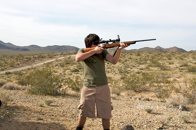 Youth firing Browning bolt action rifle .308 caliber