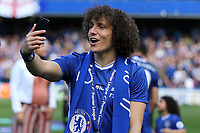 David Luiz of Chelsea celebrates winning the Premier League by taking a selfie during Chelsea vs Sunderland AFC, Premier League Football at Stamford Bridge on 21st May 2017