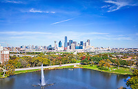 This is an aerial view of the Dallas skyline from a city park over the water feature with the usual iconic  high rise buildings in downtown area like the Bank of America, Fountain Place, Reunion Tower, Omni, Heritage Plaza. You can also see they are building the new bridge which is still a way from being completed.