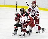 Cori Bassett (Harvard - 18), Casey Pickett (NU - 14), Leanna Coskren (Harvard - 24) - The Harvard University Crimson defeated the Northeastern University Huskies 1-0 to win the 2010 Beanpot on Tuesday, February 9, 2010, at the Bright Hockey Center in Cambridge, Massachusetts.