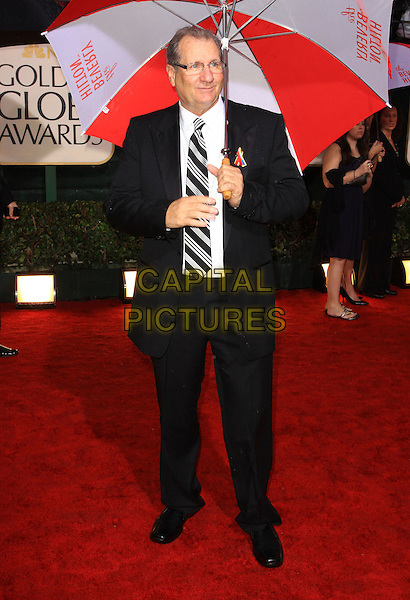 ED O'NEILL.67th Golden Globe Awards held Beverly Hilton, Beverly Hills, California, USA..January 17th, 2010.globes full length black suit umbrella.CAP/ADM/KB.©Kevan Brooks/Admedia/Capital Pictures
