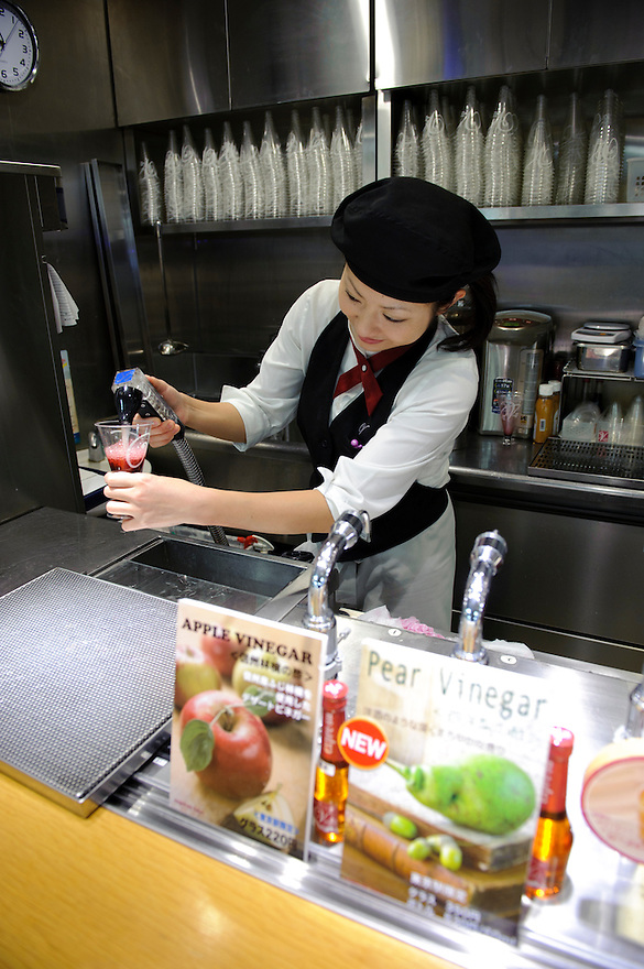 Making vinegar cocktails at an Uchibori vinegar shop in Tokyo station, Tokyo, Japan, November 16 2009. Uchibori produces a popular range of drinkable fruit vinegars.