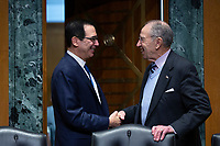 United States Secretary of the Treasury Steven T. Mnuchin shakes hands with United States Senator Chuck Grassley (Republican of Iowa) as he arrives to testify before the U.S. Senate Committee on Finance regarding the budget for fiscal year 2021 at the United States Capitol in Washington D.C., U.S. on Wednesday, February 12, 2020.  <br /> <br /> Credit: Stefani Reynolds / CNP/AdMedia