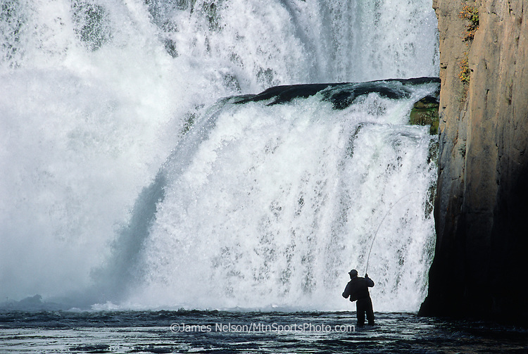 08736-C. An angler casts a fly for trout at the base of Lower Mesa Falls on the Henry's Fork, Idaho.