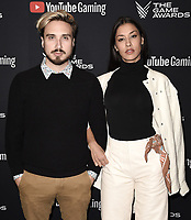 LOS ANGELES- DECEMBER 12: (L-R) Russo Schelling and Janina Gavankar attend the Game Awards 2019 at the Microsoft Theater on December 12, 2019 in Los Angeles, California. (Photo by Scott Kirkland/PictureGroup)