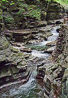 One of the 19 waterfalls seen by visitors to Watkins Glen State Park, in the Fingers Lake District of New York State. Within two miles, the glen's stream descends 400 feet past 200-foot cliffs generating 19 waterfalls along its course.