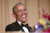 United States President Barack Obama laughs during the annual White House Correspondent's Association Gala at the Washington Hilton hotel April 25, 2015 in Washington, D.C. The dinner is an annual event attended by journalists, politicians and celebrities.<br /> Credit: Olivier Douliery / Pool via CNP