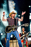 Jason Aldean performs with Lenny Kravitz at LP Field during Day 3 of the 2013 CMA Music Festival in Nashville, Tennessee.