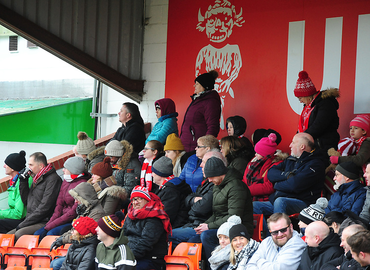 Lincoln City fans watch their team in action<br /> <br /> Photographer Andrew Vaughan/CameraSport<br /> <br /> The EFL Sky Bet League Two - Lincoln City v Grimsby Town - Saturday 19 January 2019 - Sincil Bank - Lincoln<br /> <br /> World Copyright © 2019 CameraSport. All rights reserved. 43 Linden Ave. Countesthorpe. Leicester. England. LE8 5PG - Tel: +44 (0) 116 277 4147 - admin@camerasport.com - www.camerasport.com